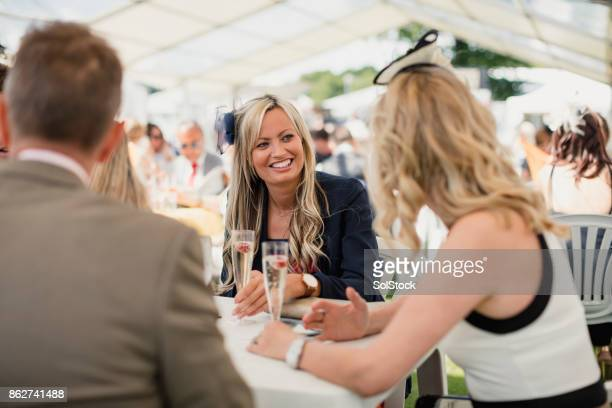 Females Enjoying a Drink in an Open Marquee