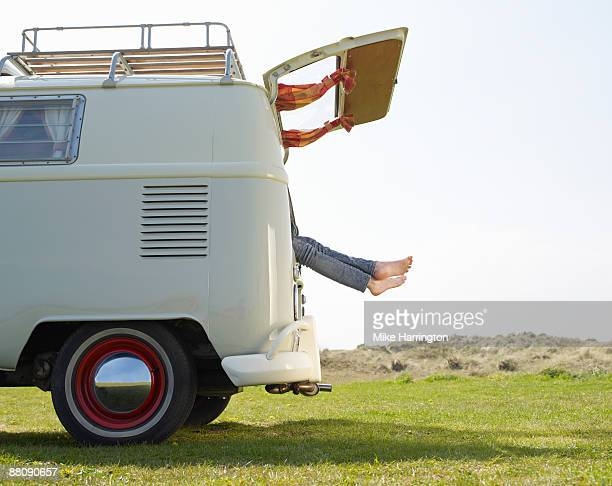 Females feet hanging out of camper van