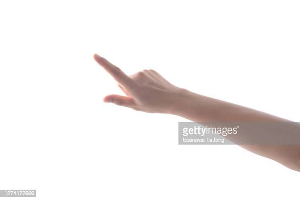 female's hand touching or pointing to something isolated on white background. close up. high resolution. - finger stock-fotos und bilder
