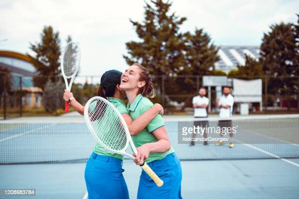 females happy for beating male competition in tennis match - tennis player stock pictures, royalty-free photos & images