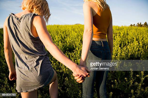 Females holding hands