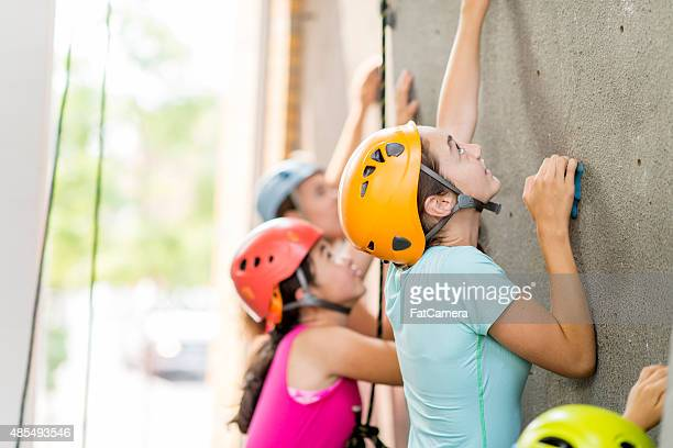 females rock climbing - teenagers only stock pictures, royalty-free photos & images