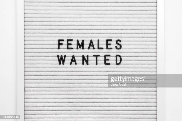 females wanted letterboard women at work - typographies stock photos and pictures
