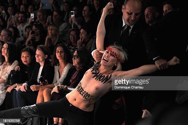 Femen activist disturbs the Nina Ricci show as part of the Paris Fashion Week Womenswear Spring/Summer 2014 on September 26, 2013 in Paris, France.