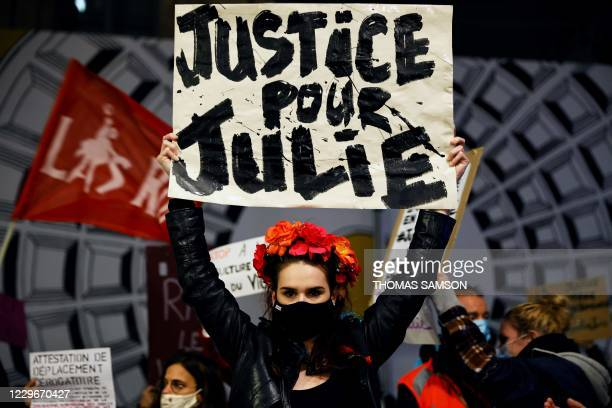 """Femen activist holds a placard reading """"Justice for Julie"""" on November 18 in Paris, during a demonstration called by feminist groups after a French..."""