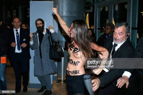 Femen activist protest against Roman Polanski during the Tribute to Roman Polanski. Held with a Retrospective of the Director's Work at Cinematheque...