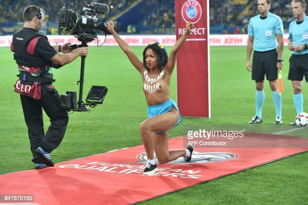 A 'femen' activist with the words 'Erdogan killer' written on her chest protests prior to the FIFA World Cup 2018 qualification football match...