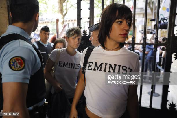 Femen activists arrive at the courthouse to attend their trial for showing their breasts during a protest at a rally against gay marriage and a...