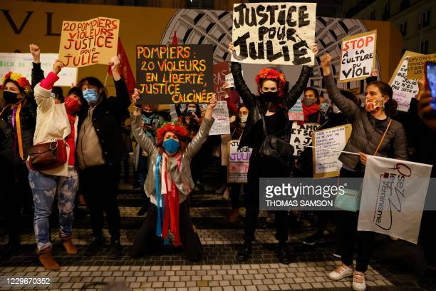 "Femen activists brandish placards reading ""20 firefighters rapists - Justice for Julie"", ""20 rapist firefighters free - Charred justice"" and ""Justice..."