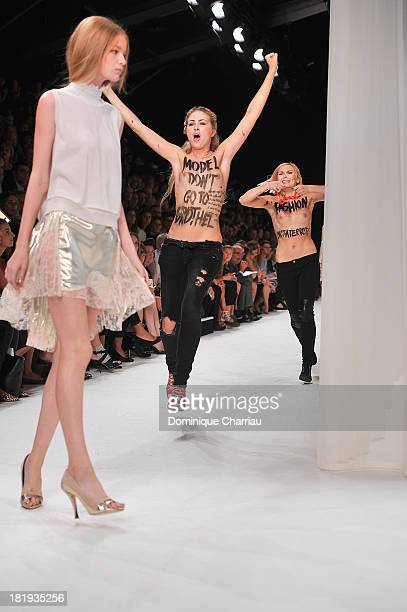 Femen activists disturb the Nina Ricci show as part of the Paris Fashion Week Womenswear Spring/Summer 2014 on September 26, 2013 in Paris, France.