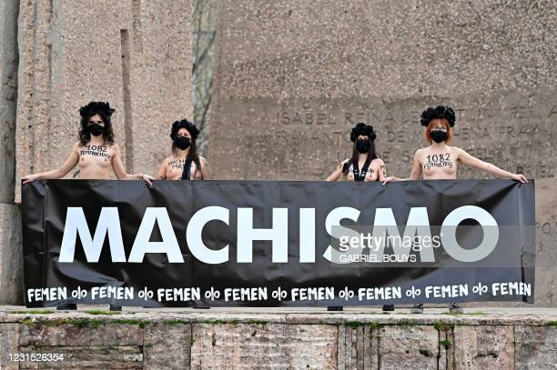 "Femen activists hold a banner reading ""Sexism"" during a protest at Plaza de Colon in Madrid on March 5, 2021 after authorities announced a ban on..."