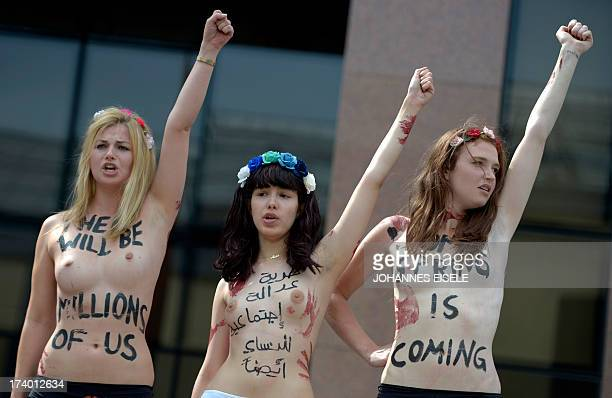 Femen activists includng Egyptian Alia El Mahdi protest in front of the Egypitian embassy in Berlin on July 19 2013 against recent rapes in that...