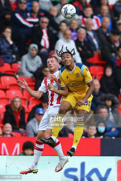 Femi Azeez of Reading FC is challenged by Tommy Smith of Stoke City during the Sky Bet Championship match between Stoke City and Reading at Bet365...