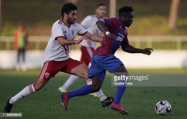 Femi Balogun of CD Cova da Piedade with Marco Grilo of UD Vilafranquense in action during the Liga Pro match between CD Cova da Piedade and UD...