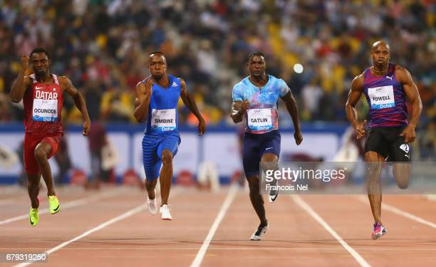 Femi Ogunode of Qatar Akani Simbine of South Africa Justin Gatlin of the United States Asafa Powell of Jamaica compete in the Men's 100 metres during...