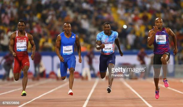 Femi Ogunode of Qatar Akani Simbine of South Africa Justin Gatlin of the United States and Asafa Powell of Jamaica compete in the Men's 100 metres...