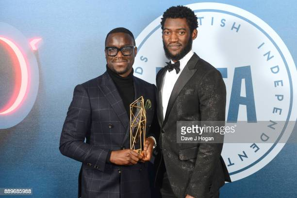 Femi Oguns winner of The Special Jury Prize presented by Malachi Kirby in the winners room at the British Independent Film Awards held at Old...