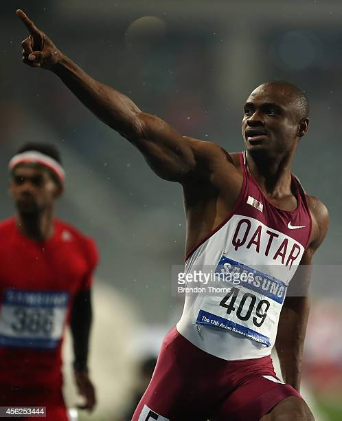 Femi Seun Ogunode of Qatar celebrates winning in the Men's 100m Final during day nine of the 2014 Asian Games at Incheon Asiad Main Stadium on...