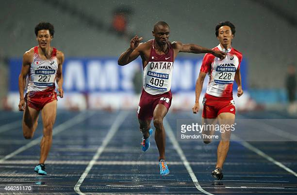Femi Seun Ogunode of Qatar crosses the finishing line to win in the Men's 100m Final during day nine of the 2014 Asian Games at Incheon Asiad Main...