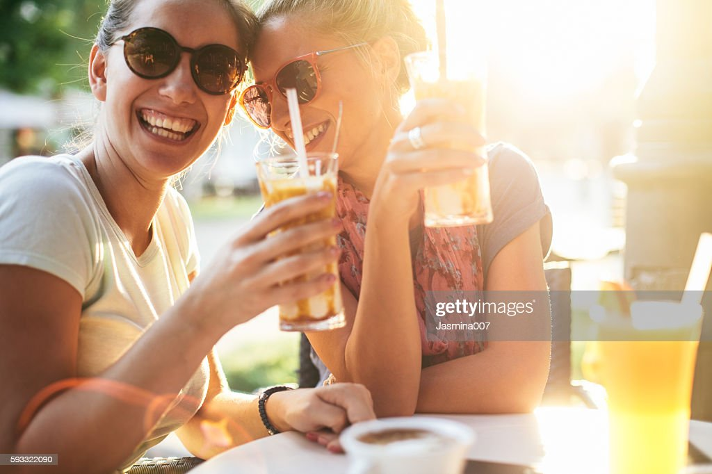Femile friends having fun at sunset : Stock Photo