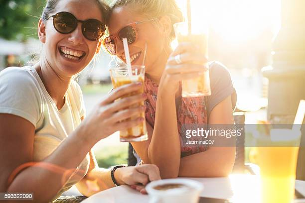 femile friends having fun at sunset - refreshment stock pictures, royalty-free photos & images