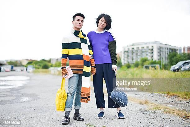 Femina China's fashion editor Austin Feng poses wearing Loewe jumper, scarf and bag, Dior pants and Nicholas Kirkwood shoes, Yilin Li poses wearing...
