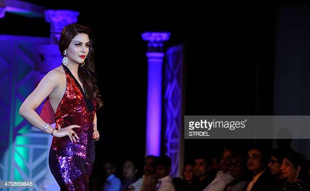 Femina Miss India International 2011 Ankita Shorey walks the ramp during the Retail Jeweller India Trendsetters 2014 show in Mumbai on February 20...