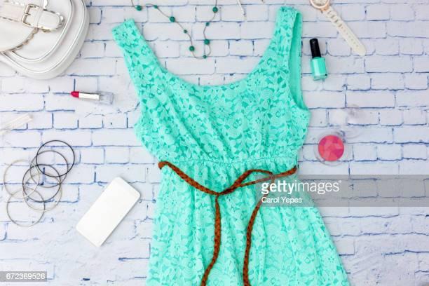 feminine clothes  top view trendy fashion turqoise feminine background.