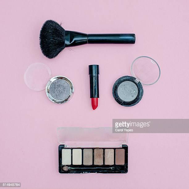 feminine cosmetic overhead making a face