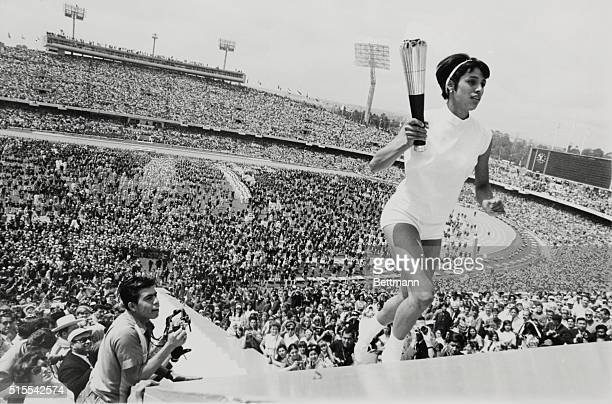 A Feminine First Mexico City Mexico's Norma Enriqueta Basilio the first woman in the history of the modern Olympic Games to light the Olympic Fire...