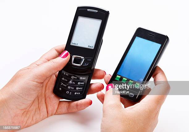 Feminine hands hold two cell phones