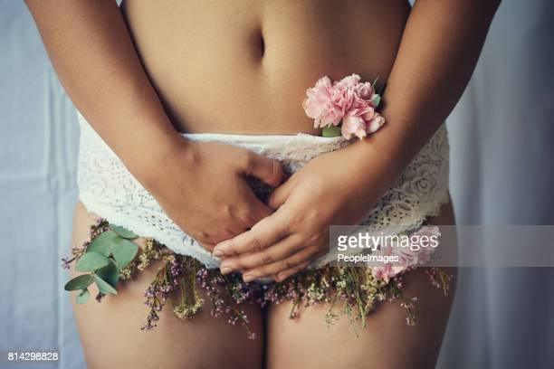 femininity in full bloom - human fertility stock pictures, royalty-free photos & images