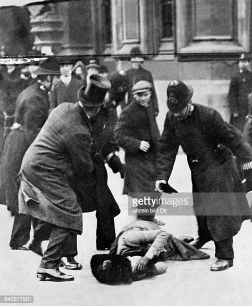 Feminism demonstration of the suffragettes before the British Parliament in London the police intervention 1910