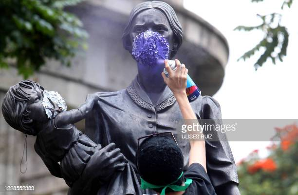 Feminist activists demonstrate against femicides and violence towards women in Guadalajara, Jalisco state, Mexico, on September 16 amid the COVID-19...