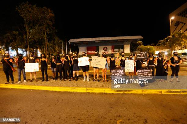 Feminist activists protest against the hiring of goalkeeper Bruno by the Boa Esporte football club in front of the club's headquarters in Varginha...