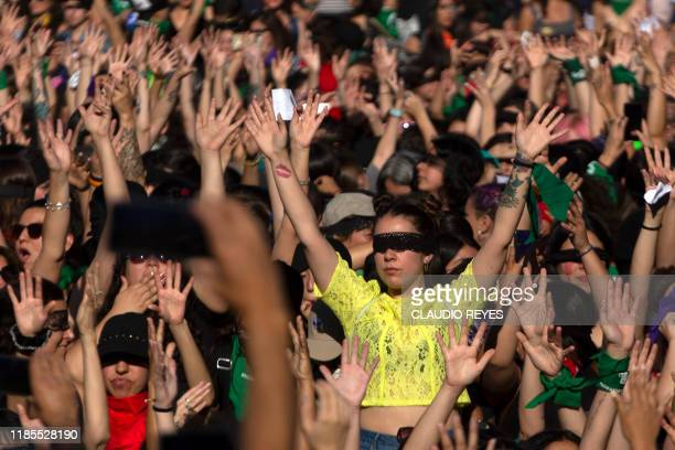 Feminist activists take part in a choreographed performance against gender violence and patriarchy in Santiago on November 29 2019 Furious Chileans...