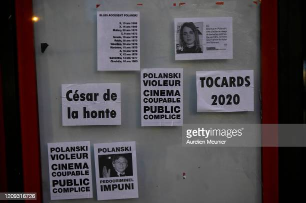 Feminist activists tracts showing actress Adele Haenel and anti Polanski are glued on a wall next to the Cesar Film Awards Ceremony to protest...