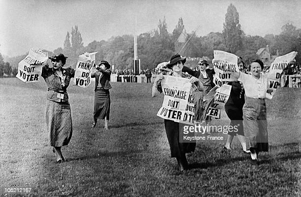 Feminist Advocates Of The Right To Vote For Women Taking Over The Field Of Longchamp Around 19301938 These Militants Are Distributing The Newspaper...