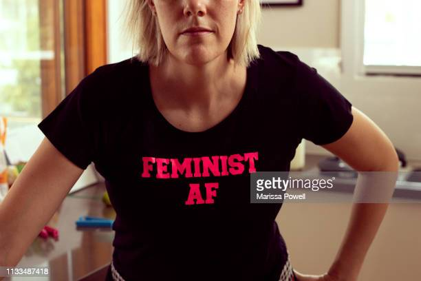 feminist af - kitchen - graphic t shirt stock pictures, royalty-free photos & images
