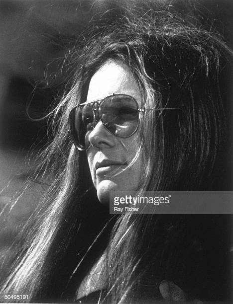 Feminist Gloria Steinem wearing her trademark aviator sunglasses during a TV interview show