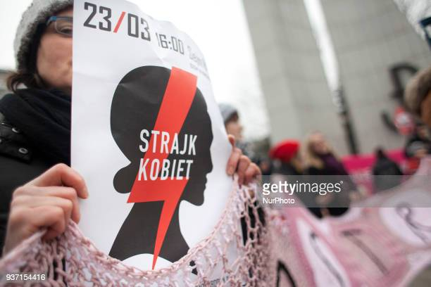 Feminist hold Women Strike poster during strike against restrictions in Abortion Law in Warsaw on March 23 2018