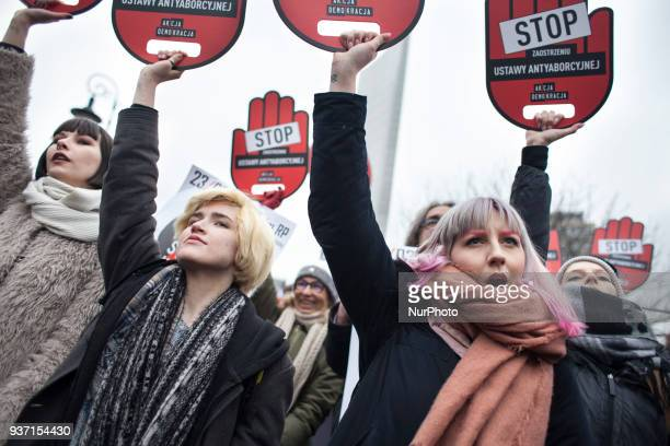 Feminist holds banners during strike against restrictions in Abortion Law in Warsaw on March 23 2018