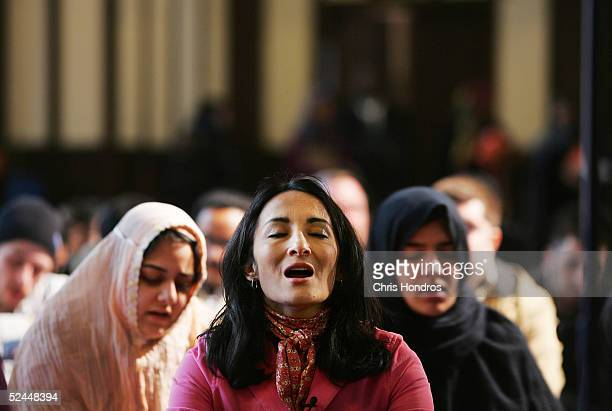 Feminist Muslim author Asra Nomani prays with other women during a rare public mixed gender womanled prayer service March 18 2005 in New York City...