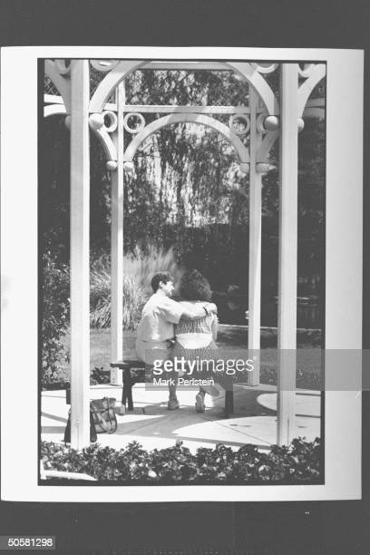 Feminist Norma McCorvey aka Jane Roe the woman behind Roe V Wade case sitting on bench w her arm around her 23 yr old daughterCheryl outside on...