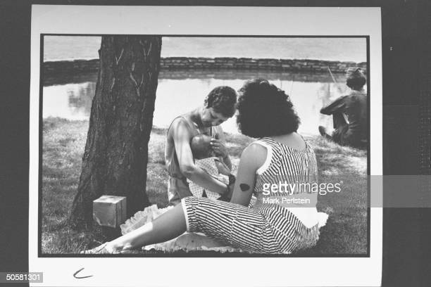 Feminist Norma McCorvey aka Jane Roe the woman behind Roe V Wade case holding her baby granddaughter as she sits on lawn chatting w her 23 yr old...