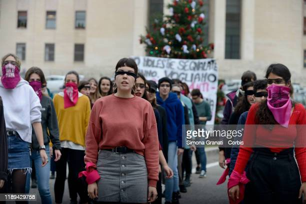 "Feminist students of the ""Non una di Meno"" group participate in a flash mob in protest against gender violence and patriarchy in Piazza della Minerva..."