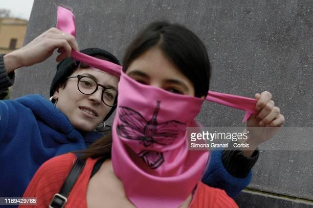 Feminist students of the Non una di Meno group participate in a flash mob in protest against gender violence and patriarchy in Piazza della Minerva...