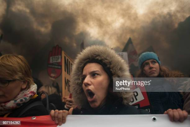 Feminists after light up a flares during strike against restrictions in Abortion Law in Warsaw on March 23 2018