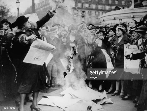 Feminists are burning some election posters to fight for women's suffrage Paris France Photograph May 12 1935