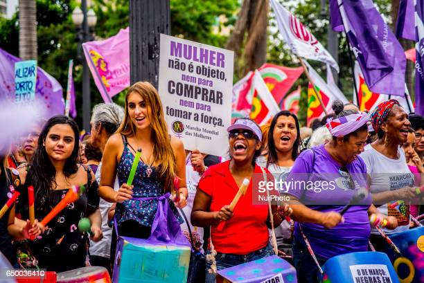 Feminists trade unionists and social movements from various sectors hold a major unified event in Praça da Sé central São Paulo on Wednesday March 8...